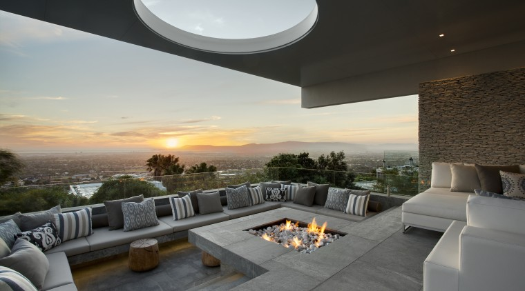 This sunken seating area, complete with firepit, allows apartment, architecture, estate, home, house, interior design, living room, property, real estate, sky, gray, black
