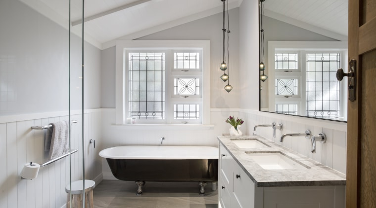 Designed Leonie von Sturmer, this bathroom balances a bathroom, bathroom accessory, countertop, floor, home, interior design, room, sink, window, gray