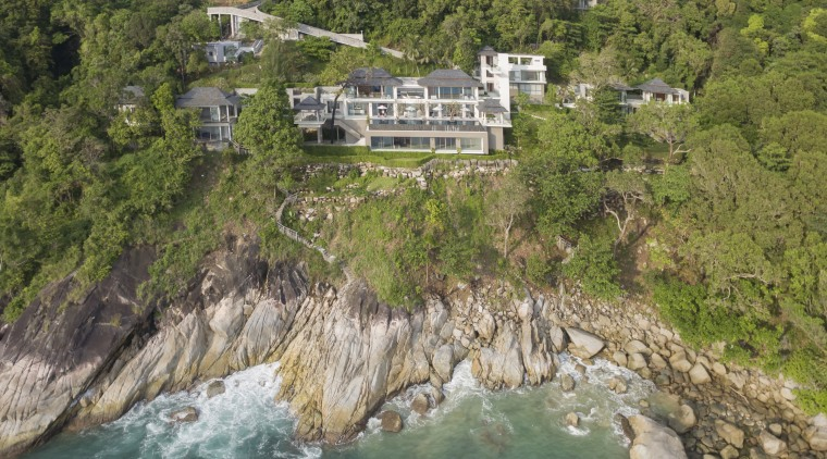 This extensive villa includes a clifftop frontage with bay, cliff, coast, coastal and oceanic landforms, cove, escarpment, geological phenomenon, hill station, nature reserve, promontory, real estate, terrain, water resources, brown