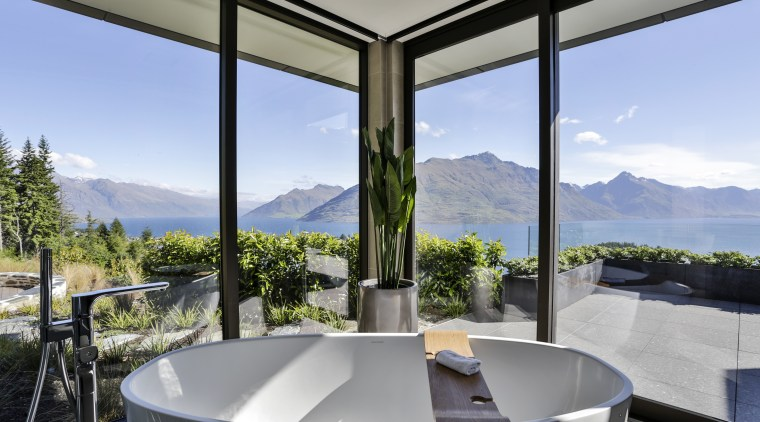 This freestanding tub has its own glass enclosure apartment, architecture, estate, home, house, interior design, real estate, window, gray, teal