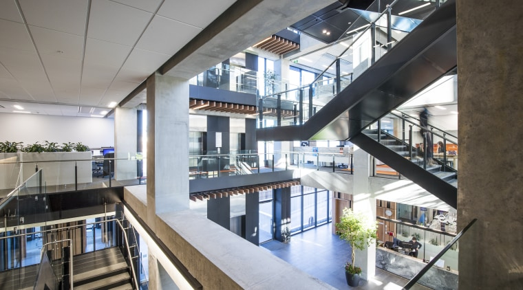 The ECAN buildings intricate bridge and stair systems daylighting, interior design, mixed use, white, gray