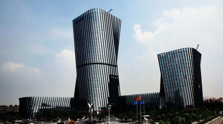 The China headquarters of global manufacturer and distributor architecture, building, city, commercial building, condominium, corporate headquarters, daytime, downtown, headquarters, metropolis, metropolitan area, mixed use, sky, skyscraper, tower block, urban area, white
