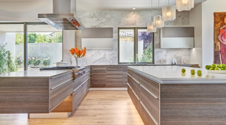 The dramatic cantilever in this kitchen is highlighted cabinetry, countertop, cuisine classique, floor, flooring, hardwood, interior design, kitchen, laminate flooring, wood flooring, gray
