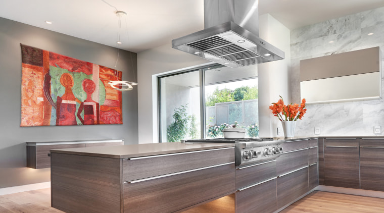 This kitchens subdued colour palette, refined, minimalist cabinetry ceiling, countertop, floor, interior design, kitchen, gray