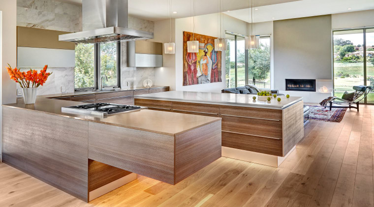 Flooded with natural light that sets off the cabinetry, countertop, cuisine classique, floor, flooring, hardwood, interior design, kitchen, laminate flooring, living room, real estate, wood, wood flooring, gray