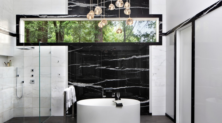 This pampering bathroom by TRG Architecture + Interior bathroom, floor, flooring, interior design, product design, shelf, tap, wall, gray, black