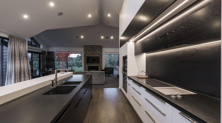 This kitchen by designer Davinia Sutton reflects the ceiling, countertop, interior design, kitchen, gray, black