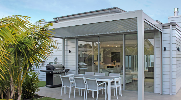 The Bask Outdoor Living Systems louvred roof and house, outdoor structure, patio, real estate, roof, gray