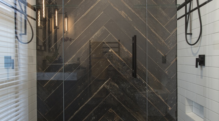 Contributing to this master suites dramatic black and bathroom, floor, flooring, glass, interior design, plumbing fixture, room, shower, tile, wall, gray, black
