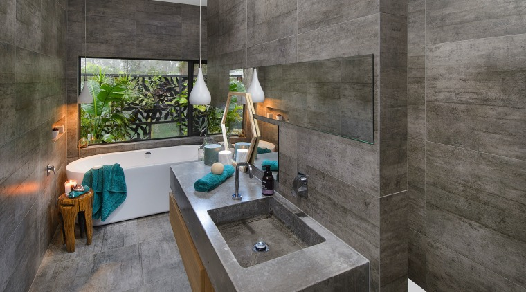 Concrete-look tiles on floors and walls create a architecture, bathroom, interior design, real estate, room, gray, black