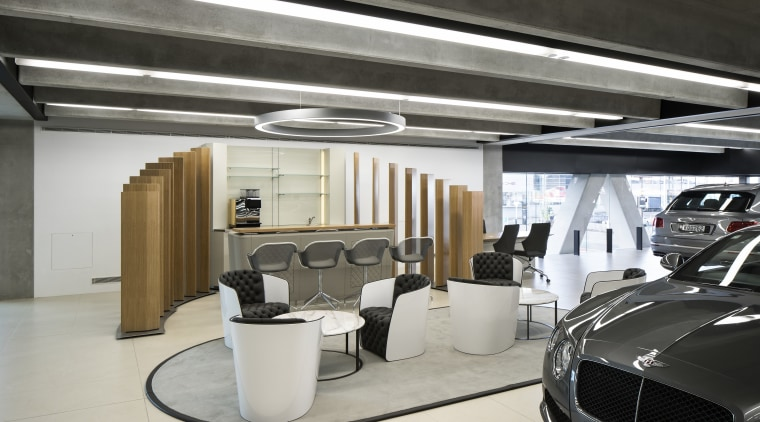 The lounge area in the Bentley section of auto show, automotive design, car, car dealership, interior design, luxury vehicle, motor vehicle, personal luxury car, vehicle, black, gray, white