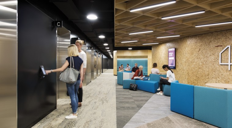 Break out spaces besides banks of lifts typify ceiling, floor, flooring, furniture, interior design, lobby, gray, brown, black