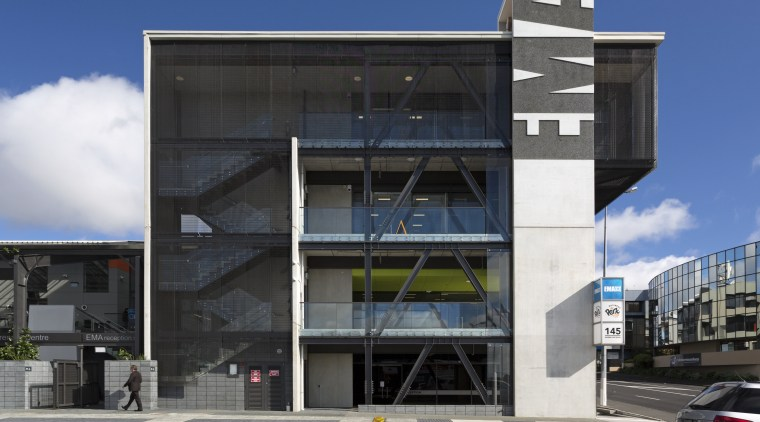 The new EMA head office building is just apartment, architecture, brutalist architecture, building, commercial building, condominium, corporate headquarters, elevation, facade, headquarters, metropolitan area, mixed use, parking, real estate, sky, black, blue