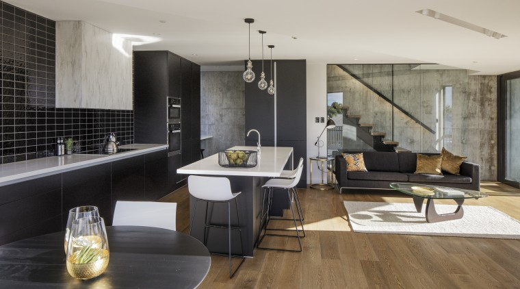 On this new kitchen project, the kitchen is architecture, floor, flooring, house, interior design, interior designer, living room, loft, gray, black