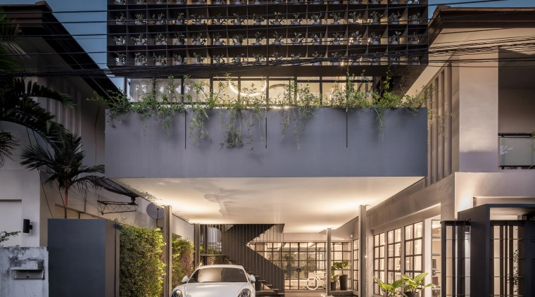 On this renovation and expansion by Anonym Studio, apartment, architecture, building, condominium, corporate headquarters, facade, house, metropolitan area, mixed use, real estate, residential area, sky, black