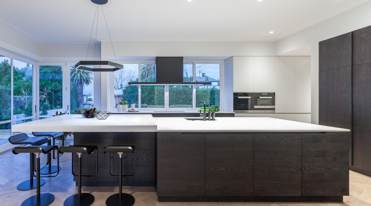 Balance is key to the serenity of this countertop, interior design, kitchen, real estate, room, black, white