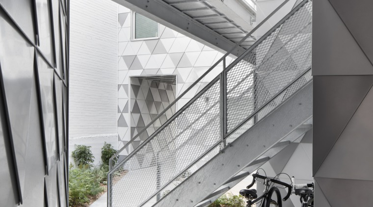 Rakish access stairs in the internal courtyard of architecture, building, daylighting, glass, house, structure, window, gray, white