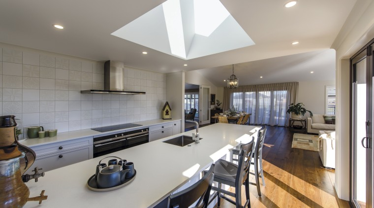 The kitchen in this Tauranga GJ Gardner showhome countertop, interior design, kitchen, real estate, room, gray