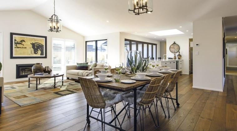 On the interior of this GJ Gardner showhome, dining room, estate, floor, flooring, hardwood, home, interior design, living room, property, real estate, room, table, white