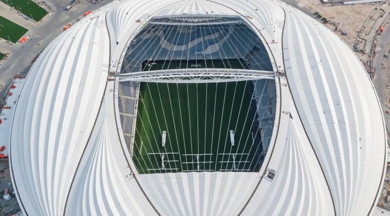 A bird's eye view of the high-tech, high-profile aerospace engineering, daylighting, grass, infrastructure, sport venue, stadium, vehicle, white, gray