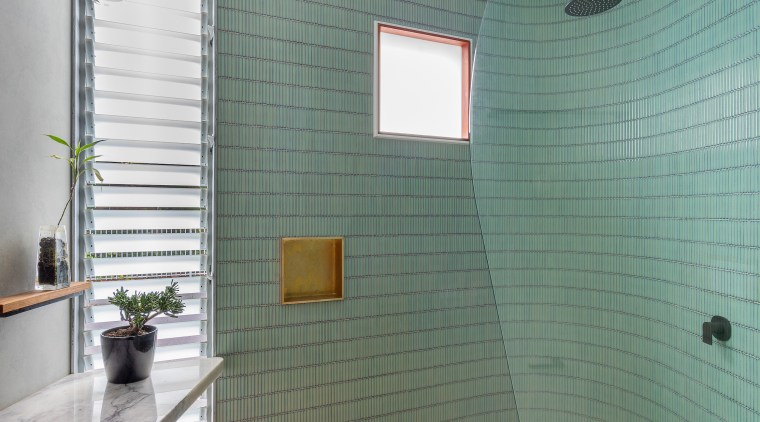 Curvaceous allure – vertically aligned jade mosaic tiles