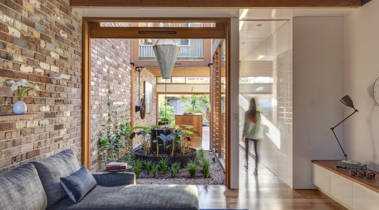 The central courtyard ensures all internal spaces are architecture, ceiling, estate, home, house, interior design, living room, real estate, wall, window, gray, brown