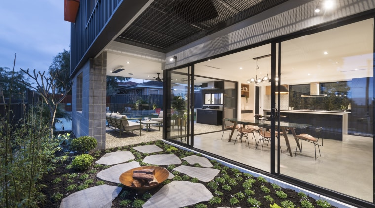 Interiors merge with exteriors to beautiful effect. apartment, architecture, building, ceiling, courtyard, design, estate, facade, home, house, interior design, mixed-use, patio, porch, property, real estate, roof, room, gray, black