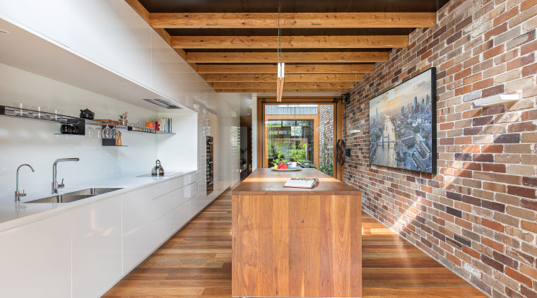 The kitchen at the back of the house ceiling, countertop, floor, flooring, hardwood, interior design, kitchen, loft, real estate, wood, wood flooring, orange, brown, gray