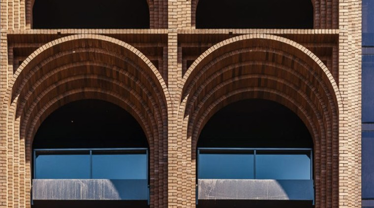 The design of Arc by Crown Group picks arch, architecture, blue, brick, brickwork, building, facade, glass, line, sky, symmetry, urban area, wall, window, brown