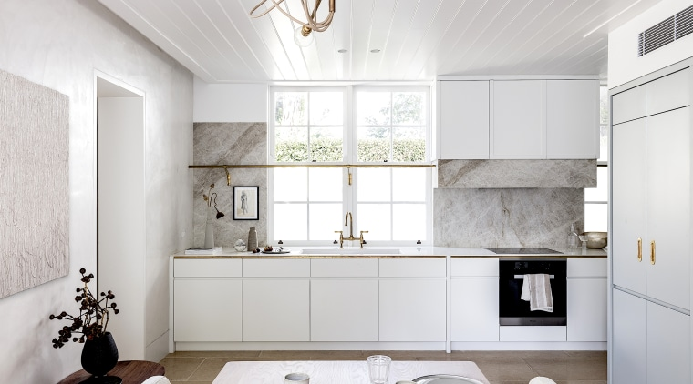 In the kitchen, two pot railings in solid white