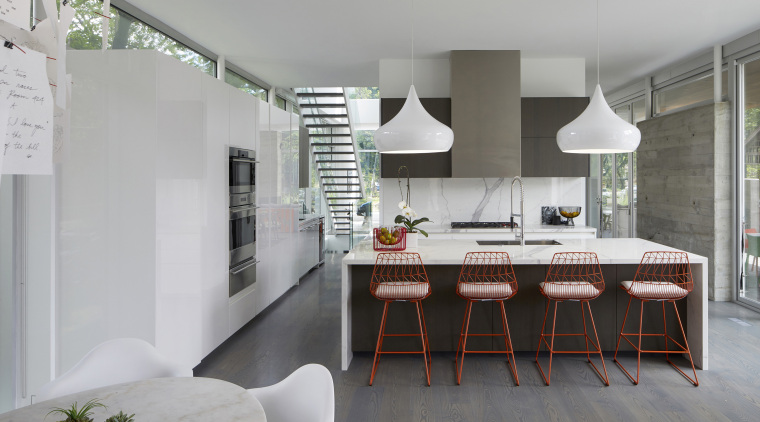 The main level of this home mostly comprises architecture, building, cabinetry, ceiling, design, dining room, floor, flooring, furniture, home, house, interior design, kitchen, living room, loft, property, real estate, room, table, white, gray