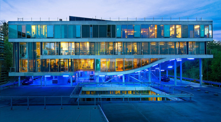 The public broadcasting centre Villa VPRO was the architecture, building, commercial building, condominium, corporate headquarters, facade, home, hotel, leisure, leisure centre, mixed use, real estate, reflection, sky, swimming pool, water, blue, teal