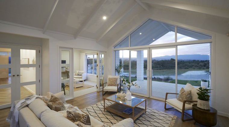 The indoor-outdoor design includes a raked portico off