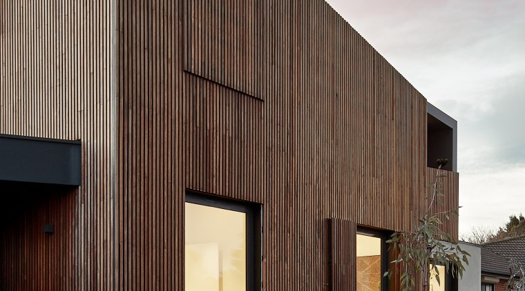 Timber screens were just one down-playing strategy used architecture, building, facade, home, house, material property, property, real estate, residential area, siding, sky, wall, wood, gray