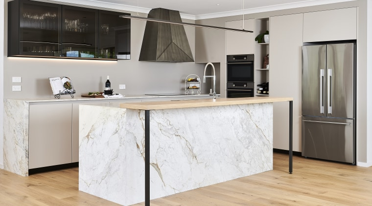 This kitchen had to work well for entertaining black-and-white, building, cabinetry, ceiling, countertop, cuisine classique, cupboard, floor, flooring, furniture, hardwood, home, house, interior design, kitchen, laminate flooring, material property, property, room, table, white, wood flooring, gray