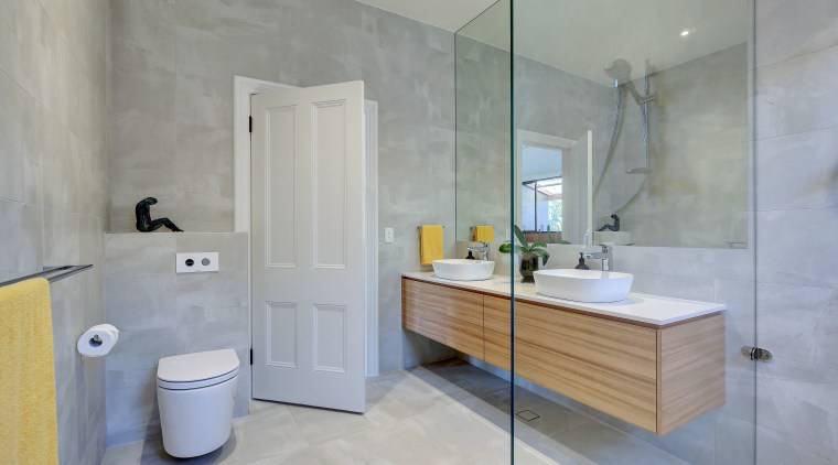 Opting for a glass shower stall extended the architecture, bathroom, building, ceramic, floor, flooring, furniture, home, house, interior design, material property, plumbing fixture, property, real estate, room, tap, tile, wall, gray