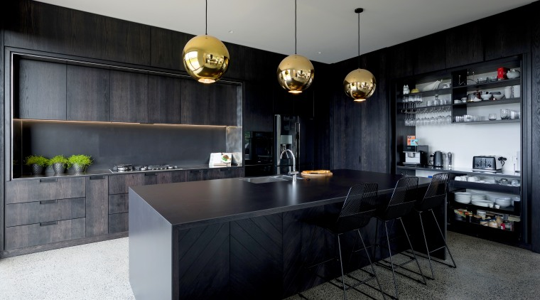 Floor-to-ceiling cabinetry provided shelving units and drawers specifically architecture, building, cabinetry, ceiling, countertop, design, floor, flooring, furniture, house, interior design, kitchen, light fixture, lighting, loft, material property, property, room, table, black, gray