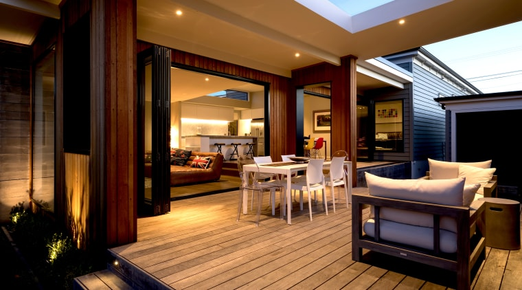 Extensive outdoor living was one positive of many architecture, building, ceiling, deck, floor, furniture, home, house, interior design, lighting, living room, property, real estate, roof, room, suite, brown