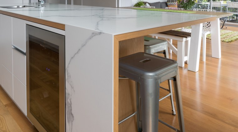 The kitchen island needing to be a zone cabinetry, countertop, cuisine classique, floor, flooring, hardwood, interior design, kitchen, laminate flooring, room, table, wood, wood flooring, gray, brown