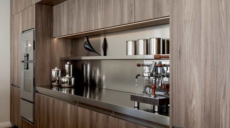 Stainless steel shelving adds to the kitchen's light architecture, building, cabinetry, ceiling, countertop, cupboard, floor, furniture, hardwood, home, house, interior design, kitchen, material property, property, room, shelf, wall, gray, brown