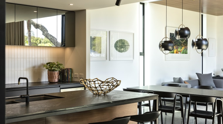 The kitchen benches are a leathered black granite,