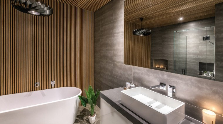 The owner of this home wanted a luxurious architecture, bathroom, bathtub, building, ceiling, floor, flooring, home, house, interior design, plumbing fixture, property, real estate, room, tap, tile, wall, gray, black, brown