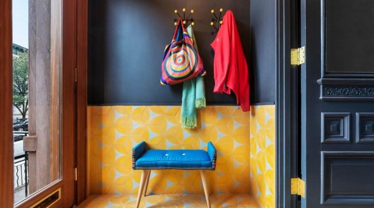Entrance - building | chair | design | building, chair, design, floor, flooring, furniture, house, interior design, orange, red, room, table, textile, yellow, black