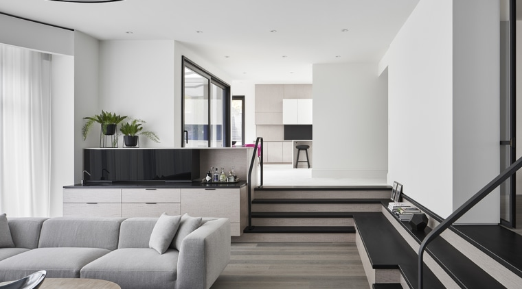 With a dividing wall removed, this home's sunken white, gray