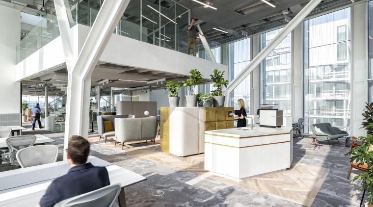 The abundance of light in the Amvest Amsterdam architecture, building, ceiling, daylighting, design, floor, flooring, furniture, home, house, interior design, living room, lobby, loft, mixed-use, office, property, real estate, room, white, gray