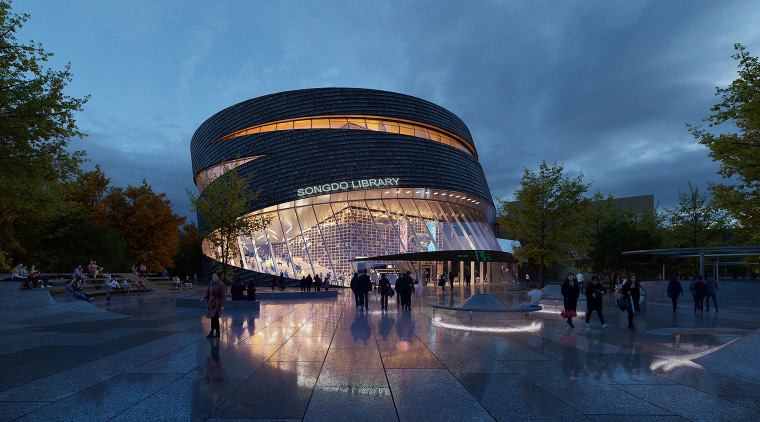 The proposed city library imagined by night.