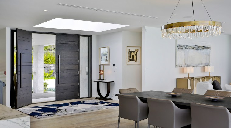 Entering through the full height double doors, the gray