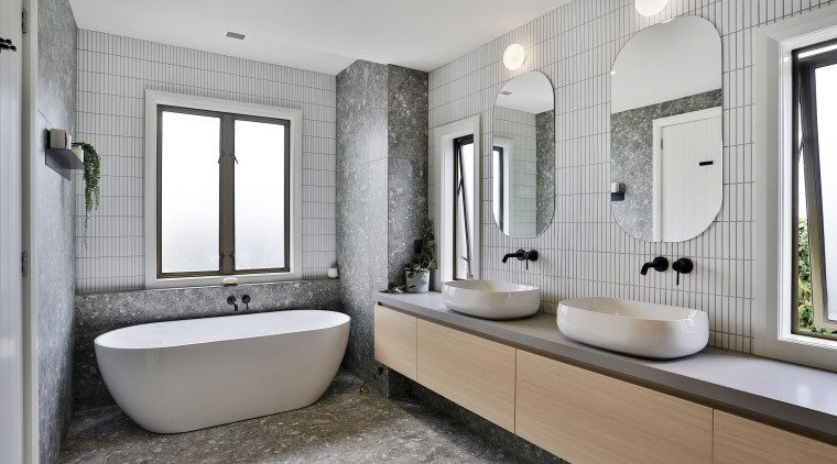 To achieve this sophisticated ensuite the designer chose