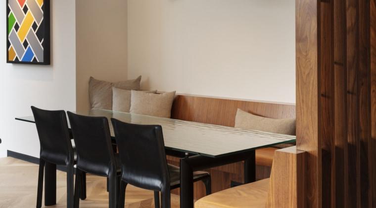 Breakfast nook with herringbone flooring -