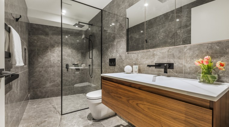 A glass shower stall panel and blanket stone-look